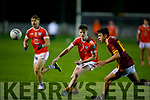 Conor Lane of Brosna keeps an eye on Ted Moloney of Duagh in the North Kerry Senior Football Championship on Friday in Listowel