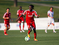 Stanley Nyazamba (99) of the Richmond Kickers brings the ball upfield during a third round match in the US Open Cup at City Stadium in Richmond, VA.  D.C. United advanced on penalty kicks after tying the Richmond Kickers, 0-0.