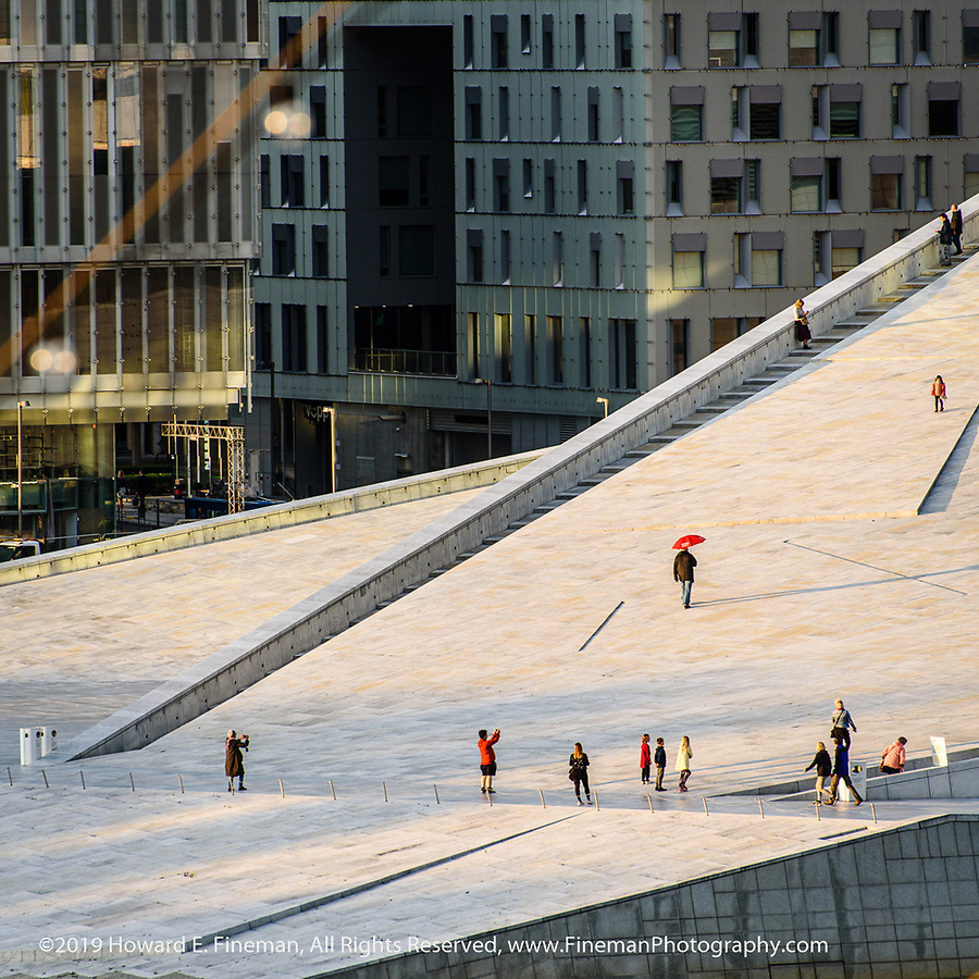 Walking up the roof of Oslo Opera House