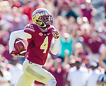 Florida State defensive back Tarvarus McFadden runs for a touchdown after scooping up a blocked field goal attempt by Delaware State in the first half of an NCAA football game in Tallahassee, Fl.  Florida State defeated Delaware State 77-6.