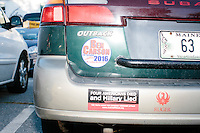 Campaign volunteers have a Ben Carson 2016 magnet and a bumper sticker referencing Hillary Clinton and Benghazi after Republican presidential candidate Dr. Ben Carson met with people at Londonderry Old Home Day in Londonderry, New Hampshire.