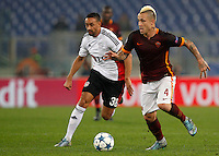 Calcio, Champions League, Gruppo E: Roma vs Bayer Leverkusen. Roma, stadio Olimpico, 4 novembre 2015.<br /> Bayer Leverkusen's Karim Bellarabi, left, and Roma's Radja Nainggolan fight for the ball during a Champions League, Group E football match between Roma and Bayer Leverkusen, at Rome's Olympic stadium, 4 November 2015.<br /> UPDATE IMAGES PRESS/Riccardo De Luca