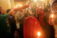 Traditional Kurdish wedding celebrations or kina gecesi in Istanbul, Turkey. Kurdish women carry candles and henna on a tray