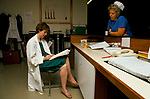 NHS 1980s Dr Maura Stafford takes a break chatting to the midwife having just performed a caesarian section birth both tired Royal United Hospital Bath Hospital Somerset 1989 . UK.