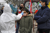 "- Milano, Febbraio 2021, la Brigata Sanitaria Soccorso Rosso, organizzazione no-profit nata da numerose associazioni di volontariato di base e con il contributo del sindacato indipendente ADL Cobas, partecipa alla campagna ""tampone sospeso"", per l'esecuzione gratuita di tamponi rapidi per la diagnosi di Covid 19 nei quartieri critici e di estrema periferia della città.<br />