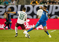 CHARLOTTE, NC - JUNE 23: Yann Thimon #14 and Andres Guardado #18 contest the ball during a game between Mexico and Martinique at Bank of America Stadium on June 23, 2019 in Charlotte, North Carolina.