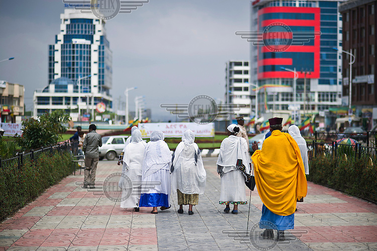 Worshipers walk along a path leading away from Madhane Alem Cathedral, the seat of the Ethiopian Orthodox Tewahedo Church.