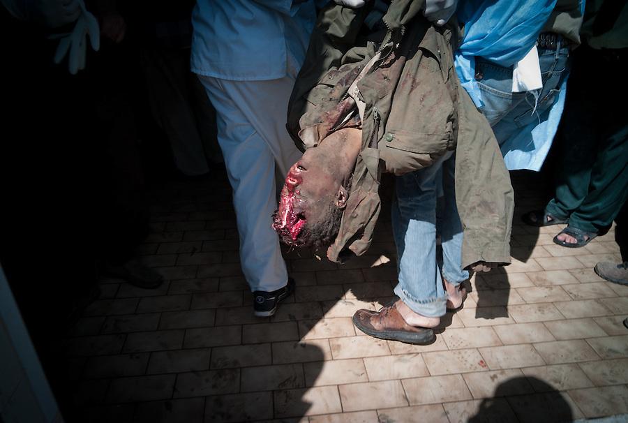 Suspected Gaddafi loyalist killed in battle. Benghazi, Libya.