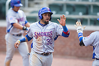 Ryan Dent (30) of the Tennessee Smokies slaps hands with a teammate after scoring the go ahead run in the top of the 13th inning against the Birmingham Barons at Regions Field on May 4, 2015 in Birmingham, Alabama.  The Barons defeated the Smokies 4-3 in 13 innings. (Brian Westerholt/Four Seam Images)