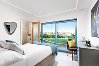 BNPS.co.uk (01202 558833)<br /> Pic: Rohrs&Rowe/BNPS<br /> <br /> Pictured: Bedroom. <br /> <br /> An exceptional contemporary clifftop home with panoramic views of not one, but two beaches is on the market for offers over £2m.<br /> <br /> Seascape is a brand new home, completed earlier this year and never lived in, that has a frontline spot next to Porthpean Beach and Duporth Beach.<br /> <br /> The sleek four-bedroom home in the village of Porthpean, Cornwall, has incredible sea views from almost every room, a full width balcony and a gate in the garden straight onto the South West Coast Path.