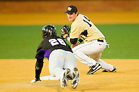 Conor Keniry #14 of the Wake Forest Demon Deacons tries to tag out Jack Havey #26 of the Northwestern Wildcats as he slides into second base with a double at Gene Hooks Field on February 26, 2011 in Winston-Salem, North Carolina.  Photo by Brian Westerholt / Four Seam Images
