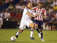 LA Galaxy defender Omar Gonzalez had a stellar evening pushes Chivas USA forward Maykel Galindo off the ball. The LA Galaxy defeated Chivas USA 1-0 to win the final edition of the 2009 SuperClásico at Home Depot Center stadium in Carson, California on Saturday, August 29, 2009...