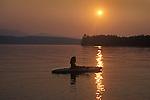 Restful kayaker at Moosehead Lake sunset, Boulton Cove and Burnt Jacket Point.