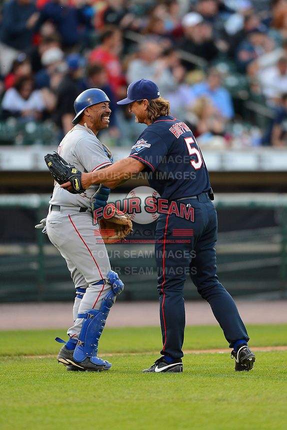 Former Kansas City Royals catcher Rey Palacios, now a firefighter for Engine 5, shakes hands with former San Diego Padres closer Trevor Hoffman #51 after finishing the MLB Pepsi Max Field of Dreams game on May 18, 2013 at Frontier Field in Rochester, New York.  (Mike Janes/Four Seam Images)