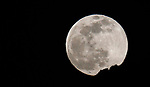 The Snow Moon rises above Prison Hill, in Carson City, Nev. on Friday, Feb. 8, 2020. <br /> Photo by Cathleen Allison/Cathleen Allison Photography