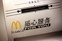 CHINA. English in use inside a McDonalds restaurant in central Beijing. The rise in use of English in China is evident on the streets of Beijing where store-fronts, billboards and clothes all sport English words and phrases. 2009