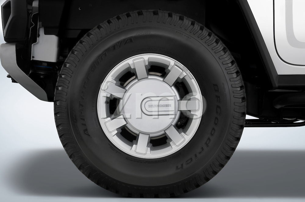 Tire and wheel close up detail view of a 2008 Hummer H2 SUV