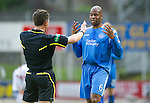 St Johnstone v Hamilton Accies...10.05.11.Michael Duberry gets a lecture from Ref Steve Conroy.Picture by Graeme Hart..Copyright Perthshire Picture Agency.Tel: 01738 623350  Mobile: 07990 594431