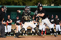 Plymouth State Panthers catcher Dan Armstrong (10) throws down to second in front of batter Garrett Bogucki (25) during the first game of a doubleheader against the Edgewood Eagles on March 17, 2015 at Terry Park in Fort Myers, Florida.  Edgewood defeated Plymouth State 12-3.  (Mike Janes/Four Seam Images)