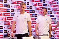 Goalkeeper Joe Hart and Wayne Rooney of England enter the press conference