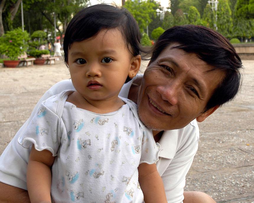 Cong Vien Le Van Tam park Saigon Ho Chi Minh City Vietnam father daughter Vietnam child dad vietnamese