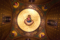 """Switzerland. Geneva. Easter Sunday at the Russian Church. The church is a lovely 19th-century Russian Orthodox church and designed in a Byzantine Moscovite style. The church's full name is Cathédrale de l'Exaltation de la Sainte Croix. The church underwent a complete revival restoration. A group of restorers from the french """"Workshop Arcoa"""" worked on the removal of adherent surface deposits by physical chemical means on paintings in the church's cupola and on the walls. Religious paintings of Jesus Christ with gold leaf used for halo, four Apostles and angels. A halo (also known as a nimbus, aureole, glory, or gloriole) is a ring of light that surrounds a person in art. The conservation-restoration of cultural heritage focuses on protection and care of tangible cultural heritage, including artworks. Easter, also called Pascha or Resurrection Sunday is a festival and holiday celebrating the resurrection of Jesus from the dead, described in the New Testament as having occurred on the third day of his burial after his crucifixion.The Russian church serves not only the Russian community but also Bulgarians, Serbs, Coptic Christians and other Orthodox worshippers who do not have their own church in Geneva. 16.04.17 © 2017 Didier Ruef"""