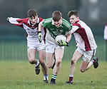 Eoin Rouine of  Ennistymon CBS  in action against James Power and Brendan Gough of  St Declan's Kilmacthomas during their Munster C Colleges football final at Rathkeale. Photograph by John Kelly.
