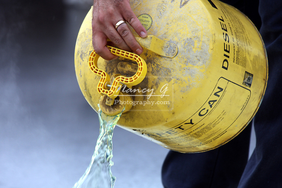 Diesel fuel being poured from a container