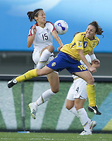 USA defender (15) Kate Markgraf collides with Sweden forward (10) Hanna Ljungberg during their Group B first round game at the 2007 FIFA Women's World Cup at Chengdu Sports Center Stadium in Chengdu, China, on September 14, 2007. The United States (USA) defeated Sweden (SWE), 2-0.