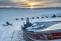 Curt Perano runs out of the Unalakleet checkpoint at sunrise on Tuesday March 16, 2015 during Iditarod 2015.  <br /> <br /> (C) Jeff Schultz/SchultzPhoto.com - ALL RIGHTS RESERVED<br />  DUPLICATION  PROHIBITED  WITHOUT  PERMISSION