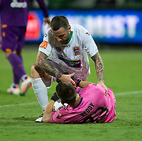 27th March 2021; HBF Park, Perth, Western Australia, Australia; A League Football, Perth Glory versus Newcastle Jets; Roy O'Donovan of the Newcastle Jets gives Liam Reddy of the Perth Glory a hand to his feet after they collides going for a through ball