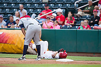 Mike O'Neill (6) of the Springfield Cardinals lays on the ground after running into Matt Fields (37) of the Northwest Arkansas Naturals at first base during a game at Hammons Field on July 28, 2013 in Springfield, Missouri. (David Welker/Four Seam Images)