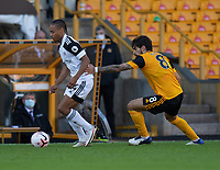 Fulham's Bobby Reid (left) under pressure from Wolverhampton Wanderers' Ruben Neves (right) <br /> <br /> Photographer David Horton/CameraSport<br /> <br /> The Premier League - Wolverhampton Wanderers v Fulham - Sunday 4th October 2020 - Molineux Stadium - Wolverhampton<br /> <br /> World Copyright © 2020 CameraSport. All rights reserved. 43 Linden Ave. Countesthorpe. Leicester. England. LE8 5PG - Tel: +44 (0) 116 277 4147 - admin@camerasport.com - www.camerasport.com