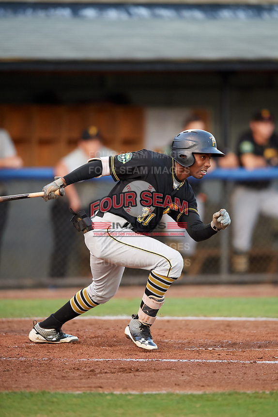 Bristol Pirates left fielder Eddy Vizcaino (31) follows through on a swing during the second game of a doubleheader against the Bluefield Blue Jays on July 25, 2018 at Bowen Field in Bluefield, Virginia.  Bristol defeated Bluefield 5-2.  (Mike Janes/Four Seam Images)