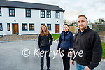 Jarek Gruszka standing with his wife Ania and daughter Oliwia at the front of their new house in Castleisland, which Tony Walsh built especially for his staff, and they hope to move in over Christmas.