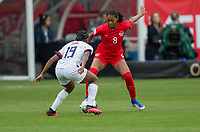 CARSON, CA - FEBRUARY 9: Jayde Riviere #8 of Canada attempts to moves past Crystal Dunn #19 of the United States during a game between Canada and USWNT at Dignity Health Sports Park on February 9, 2020 in Carson, California.