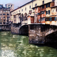 The Arno River divides Florence while the Ponte Vecchio bridges the divide as it has done for centuries.<br />