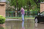 April 30, 2017- Tuscola, IL- Rob Geiler closes the gate to Ervin Park after heavy rains caused flooding across the area. [Photo: Douglas Cottle]