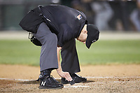 Home plate umpire Matt Baldwin cleans off the plate during the South Atlantic League game between the Hickory Crawdads and the Piedmont Boll Weevils at Kannapolis Intimidators Stadium on May 3, 2019 in Kannapolis, North Carolina. The Boll Weevils defeated the Crawdads 4-3. (Brian Westerholt/Four Seam Images)