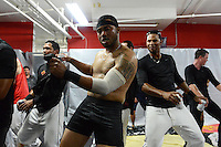 Rochester Red Wings infielder Eric Farris (no shirt) leads the dance as the team including Aaron Hicks (right) celebrates in the locker room after defeating the Scranton Wilkes Barre RailRiders on September 2, 2013 at Frontier Field in Rochester, New York to clinch the International League Wild Card Playoff spot.  (Mike Janes/Four Seam Images)