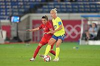 YOKOHAMA, JAPAN - AUGUST 6: Caroline Seger #17 of Sweden is marked by Jessie Fleming #17 of Canada during a game between Canada and Sweden at International Stadium Yokohama on August 6, 2021 in Yokohama, Japan.