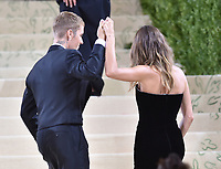 """NEW YORK, NEW YORK - SEPTEMBER 13: Justin Bieber and Hailey Bieber at the 2021 Met Gala benefit """"In America: A Lexicon of Fashion"""" at Metropolitan Museum of Art on September 13, 2021 in New York City. Credit: John Palmer/MediaPunch"""