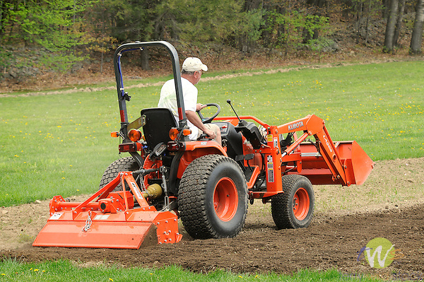 Ted Cooley rototilling garden with Kabota B7510.