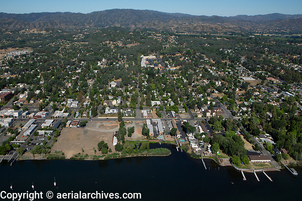 aerial photograph of Lakeport, Lake County, California showing the future Lakeport Lakefront Park, forground left and the Skylark Shores Resort and Clearlake Avenue boat ramp, foreground right.  Image date: May 31, 2021