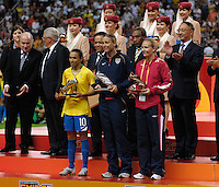 Marta of Brazil (yellow), Abby Wambach of the USA (blue), and Ragnhild Gulbrandsen of Norway, stand with the Golden, Silver and Bronze boots as the leading scorers of the tournament. Germany (GER) defeated Brazil (BRA) 2-0 in the finals of the 2007 FIFA Women's World Cup. at Shanghai Hongkou Football Stadium in Shanghai, China on September 30, 2007.