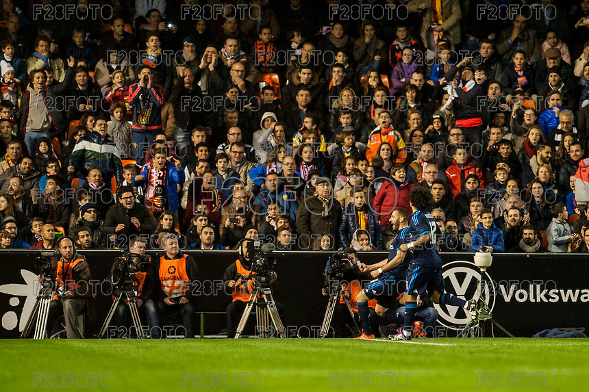 VALENCIA, SPAIN - JANUARY 3: Bencema and Marcelo celebrating a goal during BBVA LEAGUE match between Valencia C.F. and Real Madrid at Mestalla Stadium on January 3, 2015 in Valencia, Spain