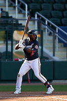 Atlanta Braves Guillermo Heredia (38) bats during a Major League Spring Training game against the Boston Red Sox on March 7, 2021 at CoolToday Park in North Port, Florida.  (Mike Janes/Four Seam Images)