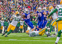"14 December 2014: Buffalo Bills running back Anthony ""Boobie"" Dixon is tackled after rushing for a 5-yard gain in the second quarter against the Green Bay Packers at Ralph Wilson Stadium in Orchard Park, NY. The Bills defeated the Packers 21-13, snapping the Packers' 5-game winning streak and keeping the Bills' 2014 playoff hopes alive. Mandatory Credit: Ed Wolfstein Photo *** RAW (NEF) Image File Available ***"