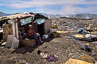 A Nicaraguan man, a garbage recollector, lives in a shack in the garbage dump La Chureca, Managua, Nicaragua, 9 November 2004. La Chureca is the biggest garbage dump in Central America. Hundreds of trash recollectors search in tons of smouldering garbage mainly metals (copper, aluminium), others concentrate on glass which is cheap, but in bigger amount. The majority of the recyclers are families with children for whom recycling is a regular job. The children very often eat the food they find on the dump, none of them goes to school, they suffer from skin diseases, they have high levels of lead and DDT in blood.