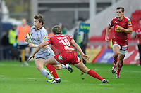 Alex Lewington of Leicester Tigers (left) steps inside Aled Thomas of Scarlets during the LV= Cup first round match between Scarlets and Leicester Tigers at Parc y Scarlets (Photo by Rob Munro, Fotosports International)